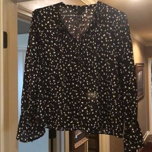 Beautiful blouse with ruffles at bottom of sleeve!